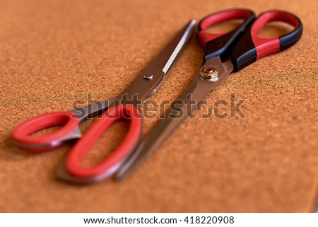 Two scissors on the cork table  - stock photo