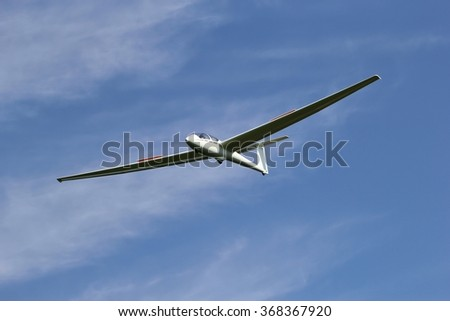 two seat glider just before landing - stock photo