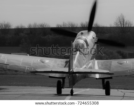 Two seat Spitfire fighter aircraft trainer taxiing Black and White