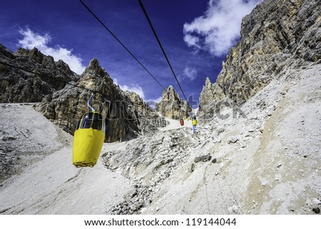 Two-seater cable car to Forcella Staunies, in the Mount Cristallo massif (Cortina d'Ampezzo, Dolomites, Italy) - stock photo