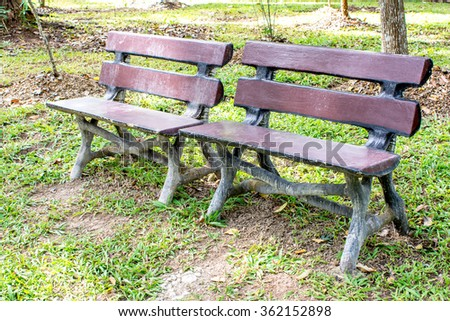 Two seating bench made from concrete look like wooden bench style in the park - stock photo