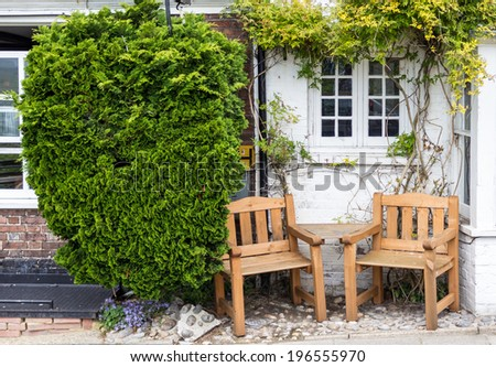 Two seats by the side of the road seen in Rye, Kent, UK - stock photo