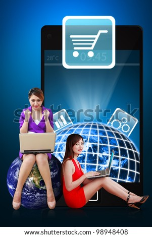 Two secretaries present the Cart icon from mobile phone : Elements of this image furnished by NASA - stock photo