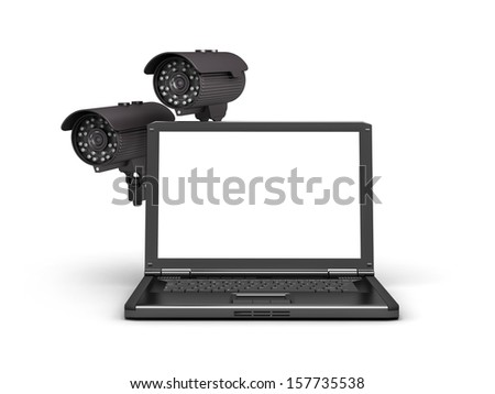 Two security cameras and laptop - stock photo