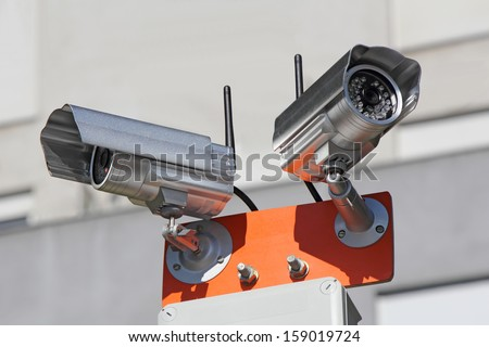 Two security cameras for monitoring building structure  - stock photo