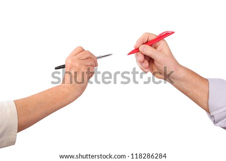 Two senior hands hold pens, isolated - stock photo