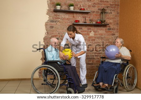 Two Senior In Wheelchairs During Physiotherapy - stock photo