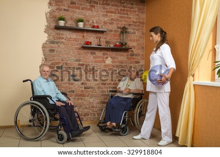 Two Senior In Wheelchairs During Physiotherapy
