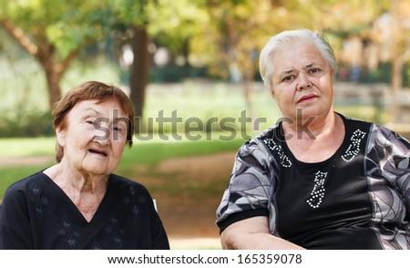 Two Senior woman outdoors - stock photo