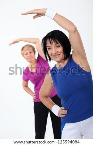 two senior women doing fitness - stock photo