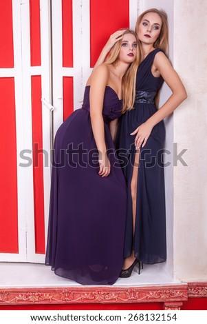 Two sensual hot woman in retro interior. Vintage style and retro interior. Sensuality and sexuality - stock photo
