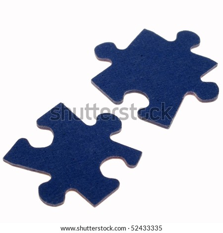 Two separated, fitting, blue, jigsaw puzzle pieces against a white background. - stock photo