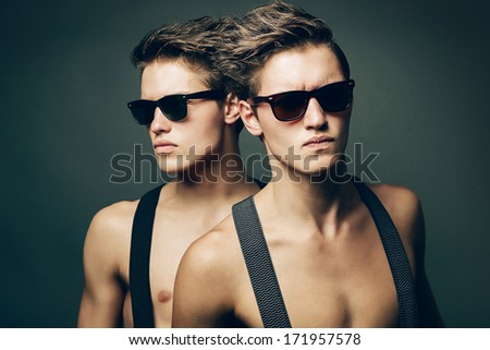 two serious men in sunglasses