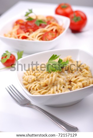 Two servings of delicious pasta - stock photo