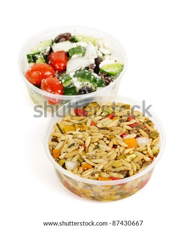 Two servings of prepared salad in plastic takeaway containers