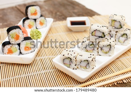 Two sets of different asian sushi - stock photo