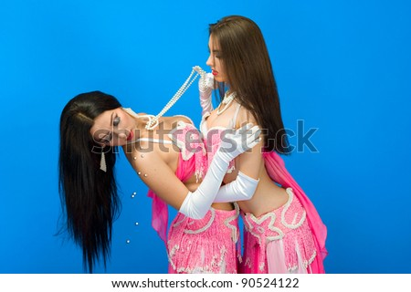 two sexy girls on blue background - stock photo