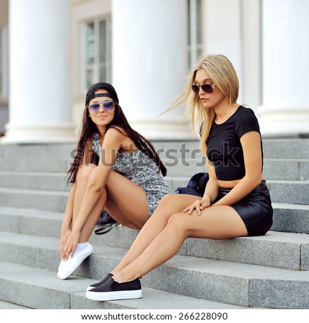 Two sexy girls posing outdoor  - stock photo