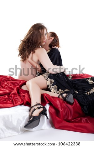 Two sexy lesbian women in bed