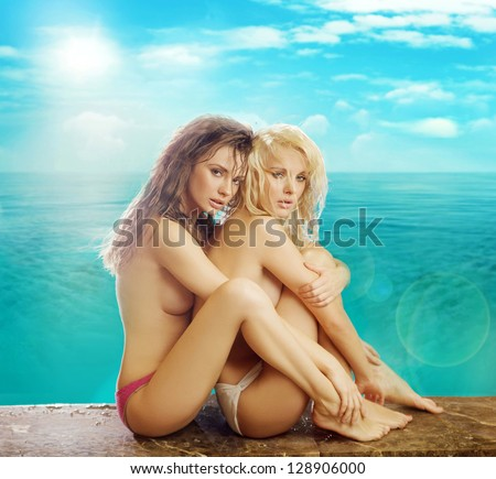 Two sexy woman at the beach - stock photo