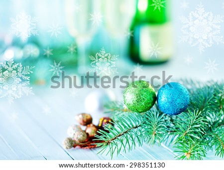 two shampagne glasses and decoration for christmas tree
