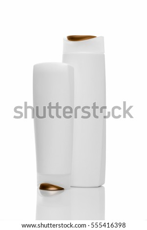 Two Shampoo bottles on white background. Brown and white bottles.