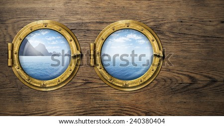 Two ship windows with tropical sea or ocean island. Travel and adventure concept. - stock photo