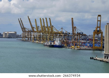 Two ships in a commercial harbor full of containers - stock photo