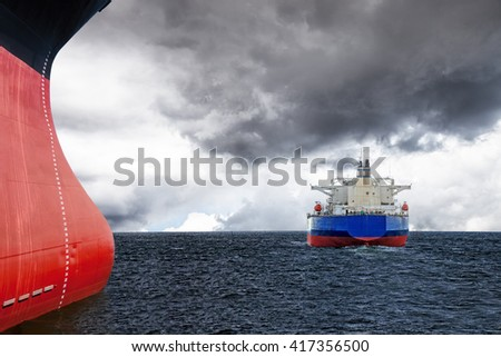 Two ships on sea in cloudy stormy day. - stock photo