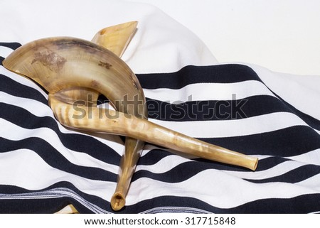 Two shofar with shawl (talit In Hebrew) - stock photo