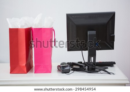 Two shopping bags on a counter at a store - stock photo