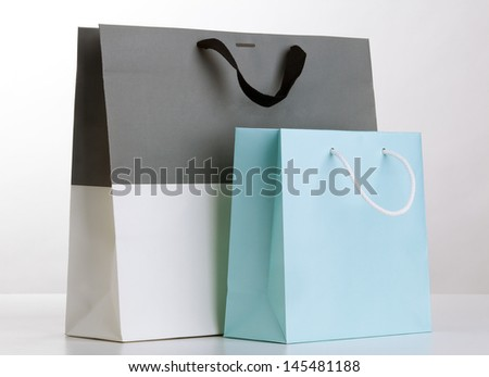 Two shopping bags on white. - stock photo