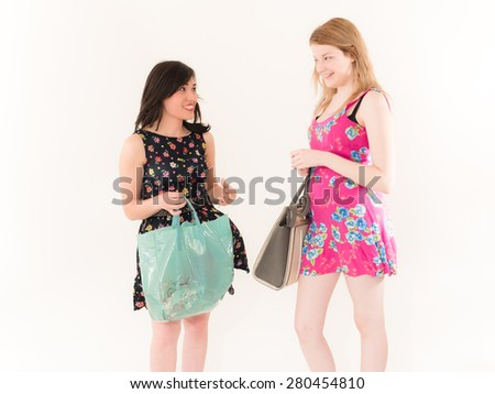 Two Shopping Women Looking at Each Other - stock photo