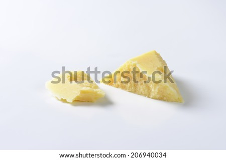 two shreds of italian parmesan cheese - stock photo
