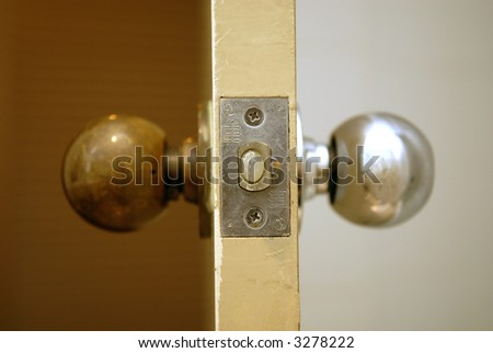 two sides of a doorknob - stock photo