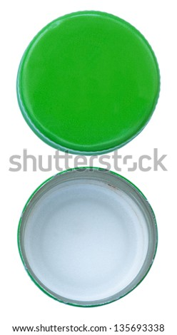 Two sides of a green metal bottle cap, seen from directly above. Isolated on white background. - stock photo