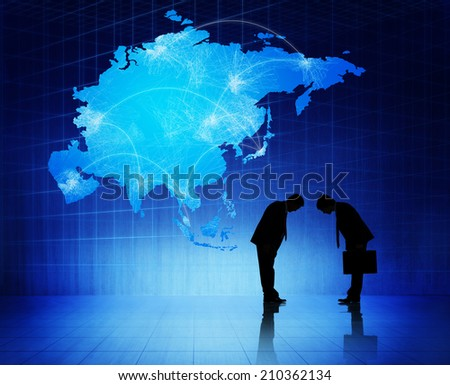 Two silhouettes of businessmen with blue cartography of Asia as a background.  - stock photo