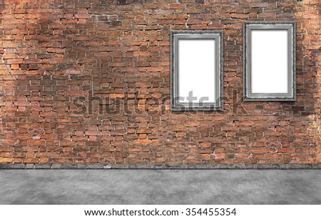 Two silver frames on old brick wall - stock photo