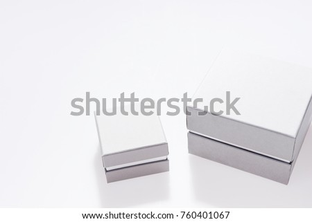 Two silver gift boxes isolated on white background. Modern presents for any holiday, christmas, valentine or birthday