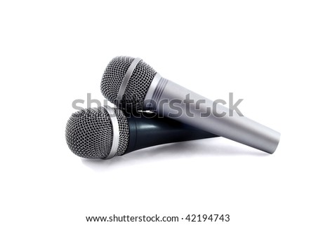 Two silver microphones isolated over white background;
