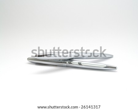 Two silver pens isolated on white background