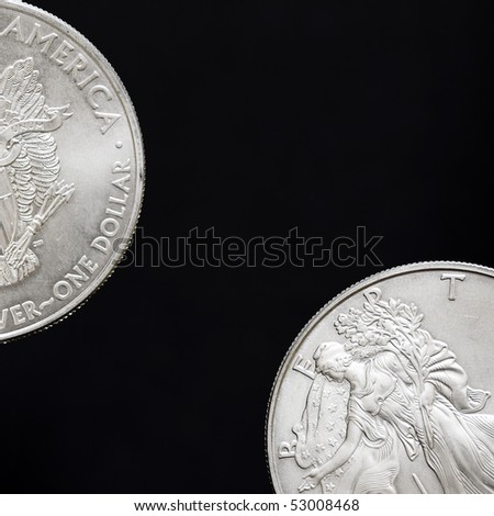 Two silver shiny dollar coins isolated on black background