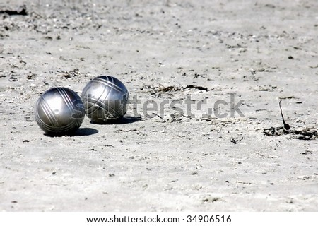 Two silvery Boule-balls in the sand - stock photo