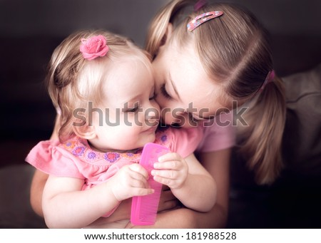 Two sister's showing affection to each other - stock photo