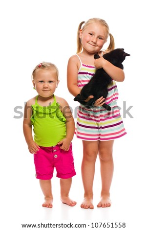 Two sister with kitty. Studio shot. - stock photo