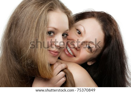 Two sisters. A portrait of two young attractive girls.Isolated on white
