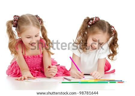 two sisters drawing with color pencils together over white - stock photo