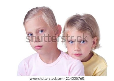 Two sisters embracing on white background - stock photo