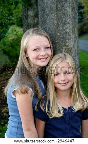 Two sisters in a park - stock photo