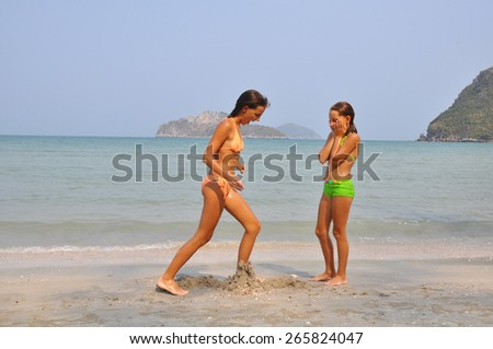 Two sisters  on the beach
